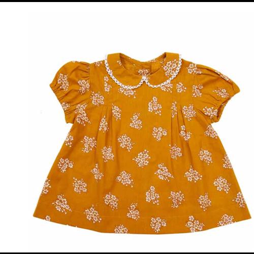 Prelepa bluza sa bubi kragnicom za devojčice oker boje sa belim cvetovima