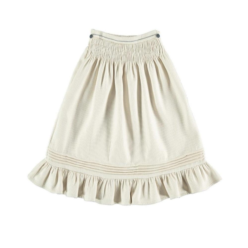 Bela suknja od punijeg organskog pamuka idealna za jesen i zimu
