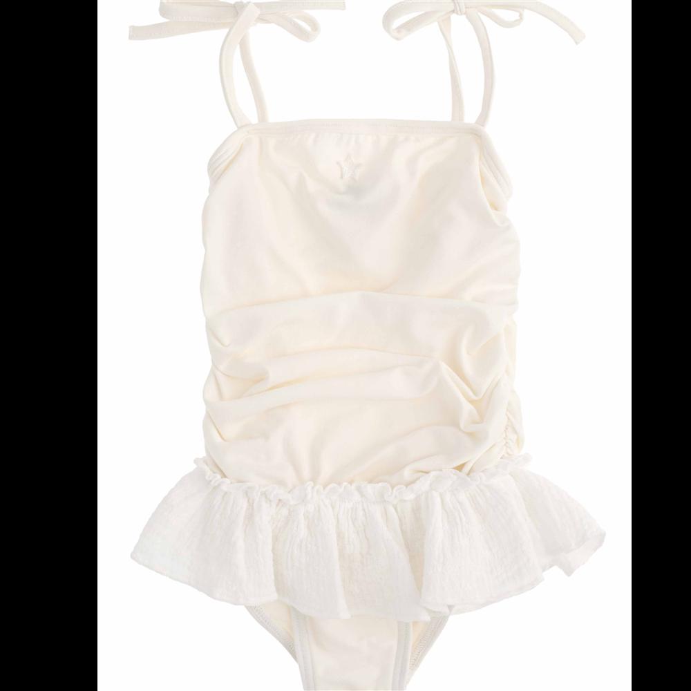 Kupaći kostim iz jednog dela bele boje sa tutu suknjicom od bele čipke