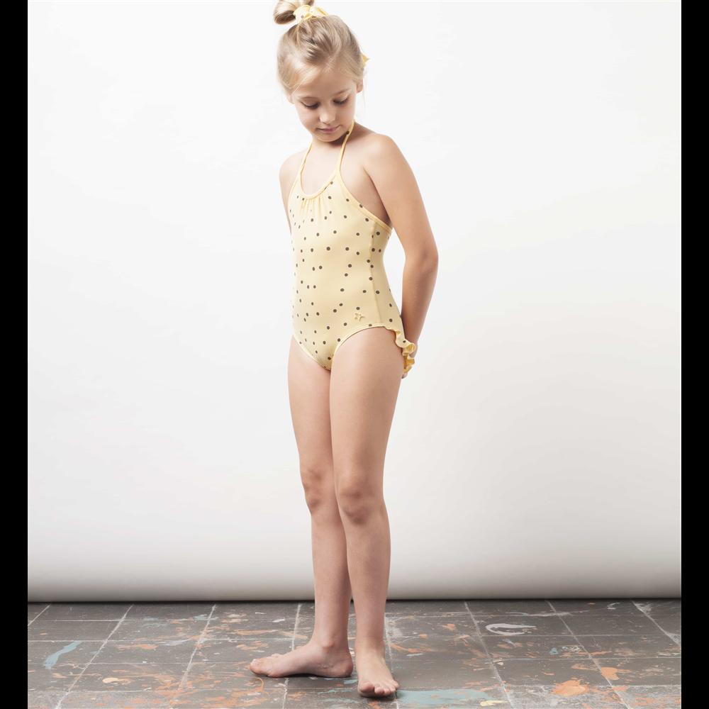 Kupaći kostim iz jednog dela žute boje sa crnim tufnicama